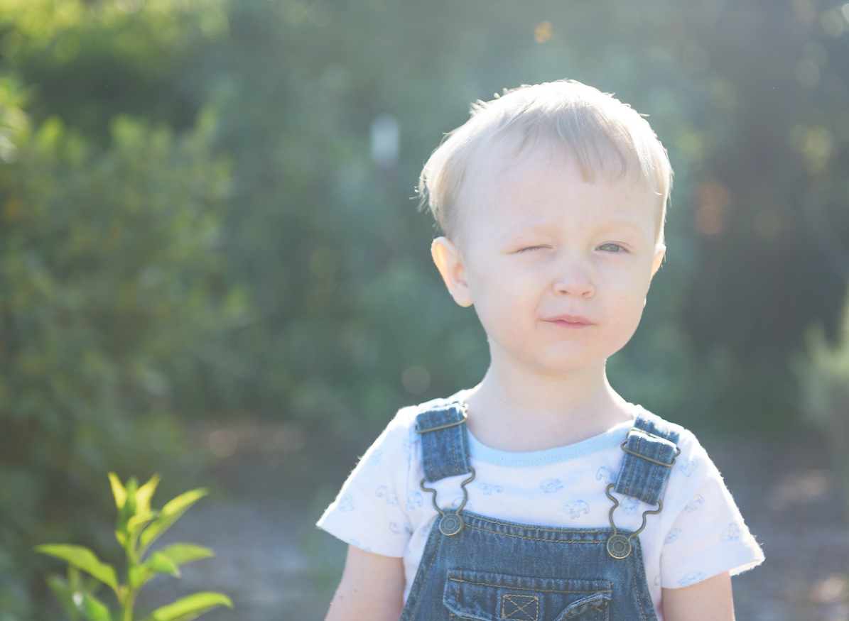 image of toddler winking
